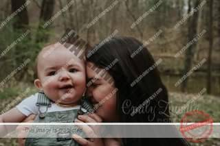 May be an image of 1 person, baby, tree, outdoors and text