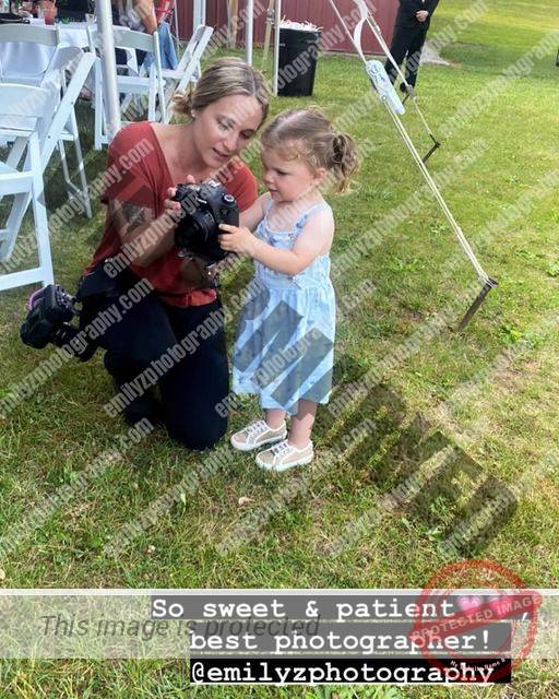 Thanks to bridesmaid Courtney for catching this precious moment at the Lanctot's...